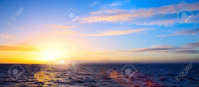 Summer sunset seascape with wide horizon of the sky and the sea